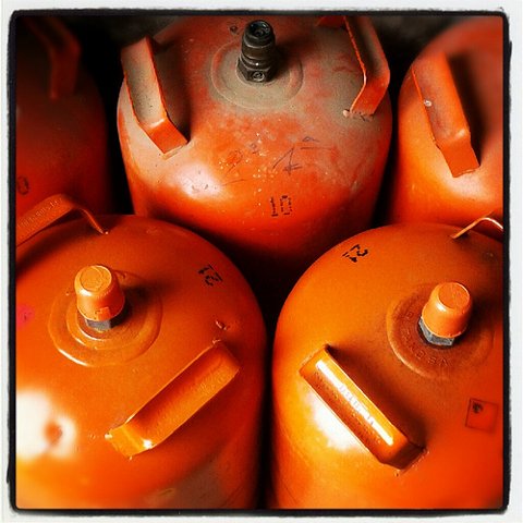 Three Orange LPG Bottles