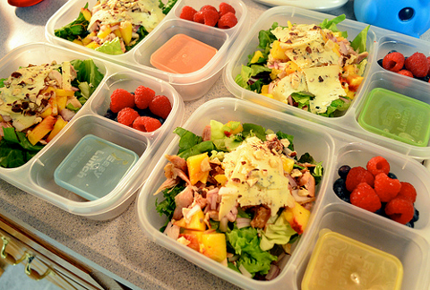 Lunch Boxes with Salads and Fruits